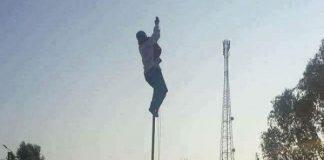 تحية العلم المغربي تجبر مديرا على تسلق عمود لإثبات وطنيته