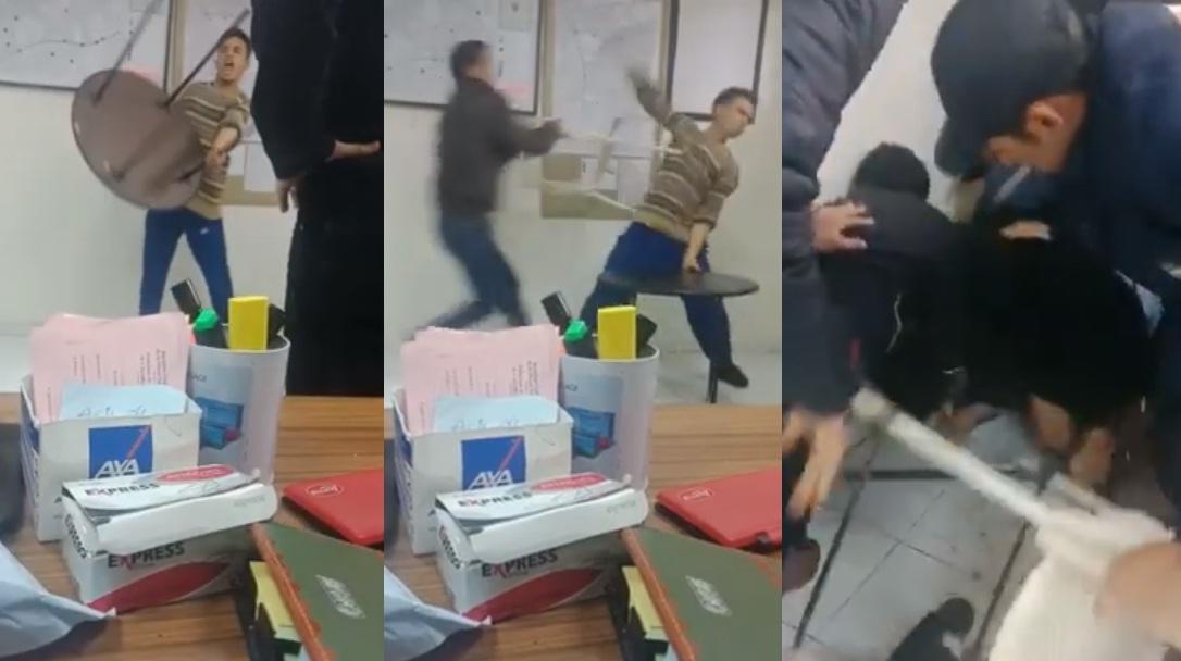 فيديو.. شاب بسلاح أبيض يثير الشغب والفوضى بمكتب الشرطة وتدخل حازم لتوقيفه